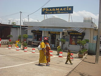 African French - French language signs outside a pharmacy in Port-Bouët, Abidjan, in 2009.