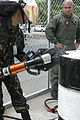 Philippine Airmen and US Marines train on aircraft crash fire rescue equipment 140506-M-UT901-056.jpg