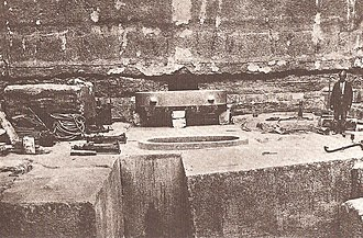 Unfinished Northern Pyramid of Zawyet El Aryan - Burial chamber with the oval sarcophagus (1905 photography).