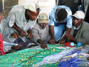 Participatory 3D modelling - Ogiek Peoples visualising their traditional spatial knowledge on a 1:10,000 scale participatory 3D model, Nessuit, Mau Forest Complex, Kenya