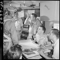 Pilot tells of dive bombing of Wake Island in ready room of USS Yorktown (CV-10). - NARA - 520801.tif