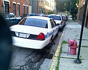 Chicago police car parked illegally in front of a fire hydrant. Note the yellow line on the curb by the hydrant.