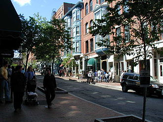 Old Port - Exchange Street, in the Old Port, viewed from the bottom of its hill, during the height of the summer tourist season.