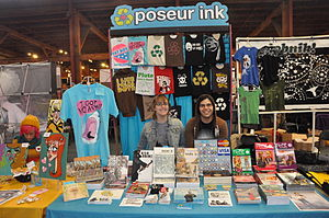 Poseur Ink - Rachel Dukes and Mike Lopez of Poseur Ink tabling at APE 2010.