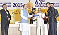 Pranab Mukherjee presenting the Swarn Kamal Award to the Film Maker Shri Kabir Khan for the Best Popular Film Providing Wholesome Entertainment, Bajrangi Bhaijan, at the 63rd National Film Awards Function, in New Delhi.jpg