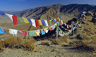 Prayer flag - Lung ta prayer flags hang along a mountain path in Nepal.