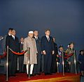 President John F. Kennedy, Prime Minister of India Jawaharlal Nehru, and Others During Arrival Ceremonies (2) (color).jpg