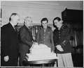 President Truman was presented with a large cake which had been baked by Master Sgt. Benedict A. Tamal, chief baker... - NARA - 198699.tif