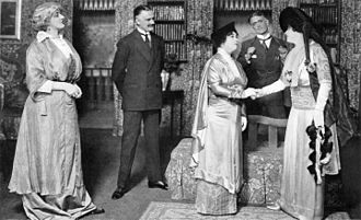 Pygmalion (play) - After creating the role of Col. Pickering in the London production, Philip Merivale (second from right) played Henry Higgins opposite Mrs. Patrick Campbell (right) when Pygmalion was taken to Broadway (1914)