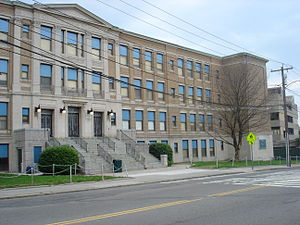 Quincy High School (Massachusetts) - The now-demolished 1924 building of Quincy High School; the new school is to the right of the photo, in the place of the now-demolished Vocational Center depicted.