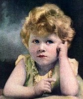 Elizabeth as a thoughtful-looking toddler with curly, fair hair