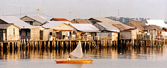 Rumah adat - A fishing village of pile houses in the Riau archipelago