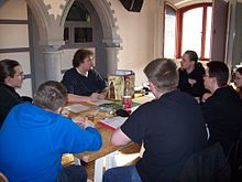 People playing The Dark Eye around a table