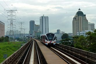 Petaling Jaya - A train of the Kelana Jaya line of the RapidKL LRT passing through Petaling Jaya.