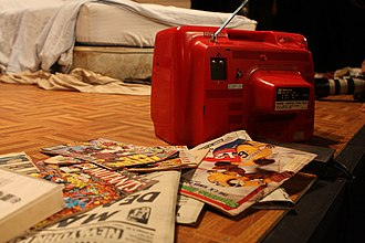 This Is Our Youth - A portable television and comic books are props on the floor of a set from This Is Our Youth at Sydney Opera House