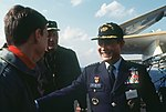Republic of Korea Air Force chief of staff General Hee Kun Lee and US Naval Forces Korea commander Rear Admiral James G. Storms III talking to pilot on USS Midway (CV-41) flight deck (DN-ST-86-04434).jpg