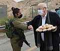 Reuven Rivlin giving sufganiyot and cakes to IDF soldiers, December 2020 (GPOABG 0309).jpg