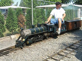 Powerland Heritage Park - Person driving large-scale model railroad locomotive
