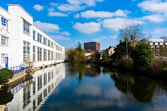 River Len - The mill pond, with the former Rootes showroom on the left.