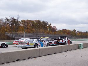 Formula Libre - Formula Libre-type field on the starting grid before an exhibition race at Road America. The event featured NASCAR Cup and Truck Series vehicles against local late models and other stock cars.