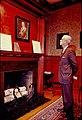 Robert E. Barrett Jr looking at father's photo in directors' room.jpg