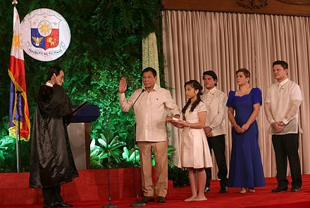 Duterte takes his oath of office as the 16th President of the Philippines before Associate Justice Bienvenido L. Reyes at Malacanang Palace while his children look on, June 30, 2016. Rodrigo Duterte oath taking 6.30.16.jpg