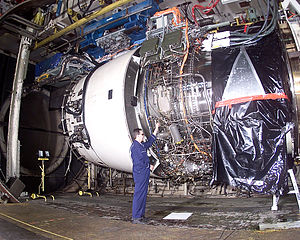 Mechanic working on a Rolls Royce Trent 900 en...