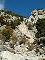 Sabine Beckmann Crag with traces of seasonal waterfall above sanctuary Kato Syme 11 05.jpg