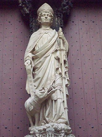 Romanus of Rouen - Status of Romanus resting on a column in the doorway of the Rouen cathedral library.