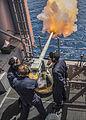 Saluting gun is fired aboard USS Essex (LHD-2) in June 2015.JPG