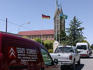 German Argentine - Flags of Argentina, Buenos Aires Province and Germany in front of St. Joseph Catholic Church in San José, Coronel Suárez Partido, Argentina
