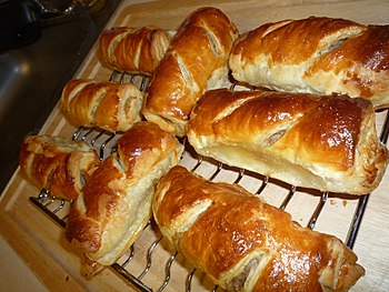 English: Sausage rolls cooling on a wire rack