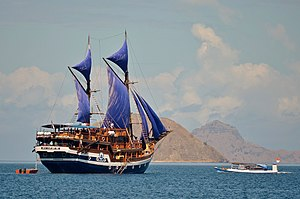 Malay Archipelago - Pinisi sailing ship exploring Komodo island, part of Lesser Sunda Islands