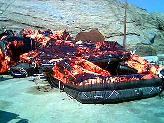 MS Sea Diamond - Empty life rafts automatically released in water, now covered with oil slicks from the Sea Diamond