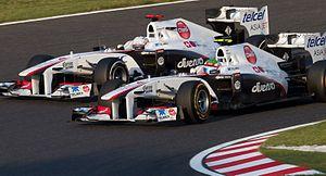 Peter Sauber - Formula One 2011 Rd.15 Japanese GP: Sergio Pérez (Sauber) overtaking Kamui Kobayashi (Sauber).