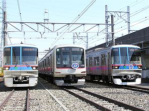 Toei Mita Line - 6300 series (left and right) and Tokyu 5080 series (center) at Shimura depot