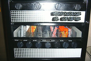 A fully-mechanical snack vending machine