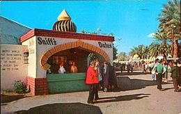 Stan Sniff, a local date grower's booth at the annual National Date Festival and Riverside County Fair, selling dates which is one of the region's most popular crops. Indio during the 1950s.