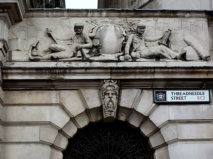 Heraldic grouping above main entrance to the surviving South Sea House, Threadneedle Street, rebuilt after the fire of 1826 South Sea House - Portal.jpg