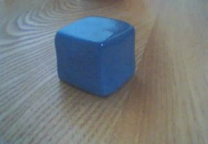 Silly Putty - Silly Putty in the form of a solid cube