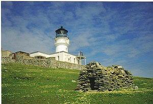Flannan Isles Lighthouse - The lighthouse on Eilean Mòr. The Chapel of St Flannan can be seen on the slope to the right of the lighthouse.