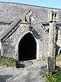St Wyllow church porch, sundial and wayside cross.jpg
