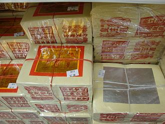 Joss paper - Traditional joss paper (金紙) sold in stacks at a store
