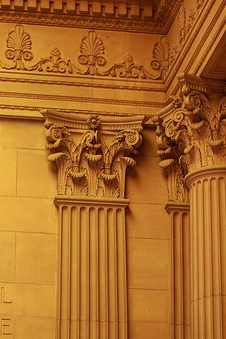 Pilaster - Detail of pilaster and entablature (with column on right) in Sydney sandstone in the entry of the Mitchell Library in Sydney, Australia