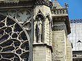 Statue beside rose window.jpg