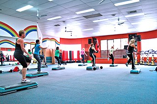 Aerobics form of physical exercise that combines rhythmic aerobic exercise with stretching and strength training routines