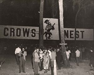 "Students gathered by the Crows Nest banner (University of Houston, ""Frontier Fiesta"", 1950s).jpg"