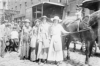 """Vera Wentworth - New York, August 1913. """"Suffragettes on hike to Boston."""" Front to back - Elsie McKenzie, Elisabeth Freeman, Vera Wentworth and 'Colonel' Ida Craft (with sash). 'Asquith' the horse pulled the caravan. According to contemporary reports he needed much urging, hence his name!"""