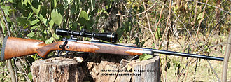 Winchester Model 70 - Winchester Model 70 Super Grade 2012 model chambered for .30-06 Springfield.  Two-piece scope mount.