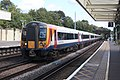 Surbiton - SWR 444027+444007 (Stagecoach livery) down train.JPG